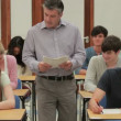 Teacher collecting tests — Stock Video