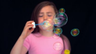 Girl making bubbles in slow motion — Stock Video