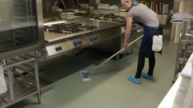 Cleaner wiping the floor in a kitchen — Stock Video