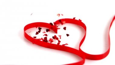 Lots of confetti falling on the heart ribbon — Stock Video