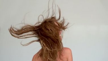 Woman shaking her hair after a shower — Stock Video
