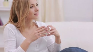 Calm woman thinking while drinking a hot drink — Stock Video