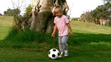 Child dribbling with the football — Stock Video