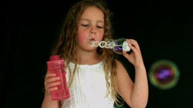 Little girl making bubbles — Stock Video