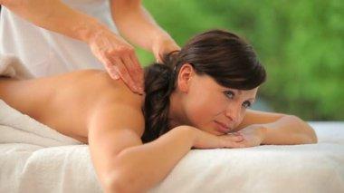 Joyful woman being massaged in a spa — Stock Video