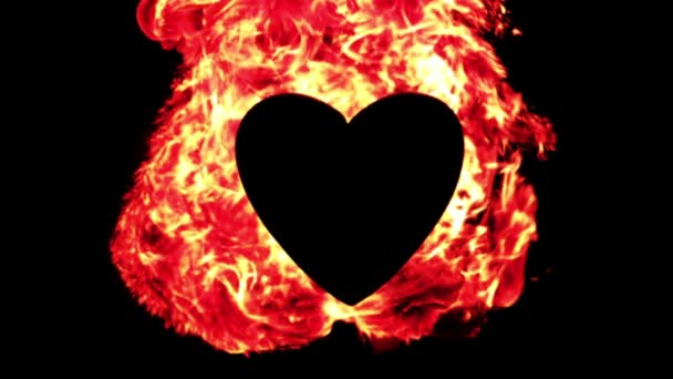 Llama de fuego ardiendo alrededor de un corazón — Vídeo de stock