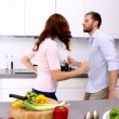Stock Video: Couple dancing and acting silly in kitchen