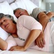 Mature couple sleeping together — Stock Video