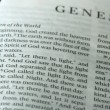 Vídeo Stock: Rosary beads falling onto book of genesis