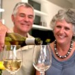 Smiling man pouring glass of white wine for his wife — Stock Video
