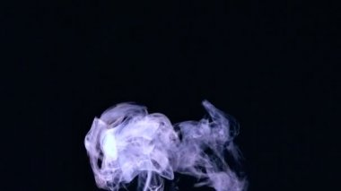 Rising puff of smoke on black background — Stock Video