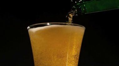 Bottle pouring beer into glass — Stock Video
