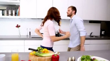 Couple dancing and acting silly in the kitchen — Stock Video