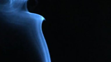 Blue smoke rising on black background — Stock Video