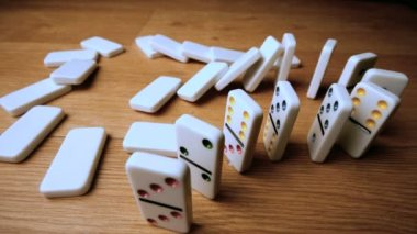 The domino effect on wooden table high angle shot — Stock Video
