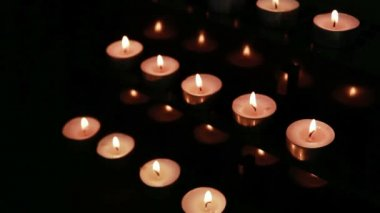 Candles at an alter being blown out — Stock Video