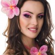 Beautiful woman with orchid flower — Photo