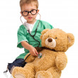Boy playing doctor — Stock Photo #26794507