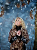 Woman in snow winter forest — Stock Photo