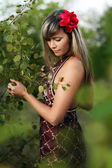Woman in the forest near the tree — Stock Photo