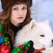 Young beaytiful woman in fur hats in winter forest with dog Samo — Stock Photo