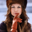 Young beaytiful women in fur hats in winter forest — Stock Photo #22271899