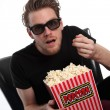 Stock Photo: Amazed man in 3D-glasses popcorn