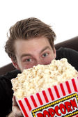 Man looking up from the popcorn — Stock Photo