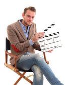Muž, který držel film břidlice — Stock fotografie