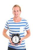 Uomo felice tenendo un orologio — Foto Stock