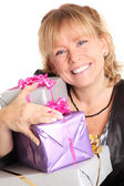 Happy woman with presents — Stock Photo