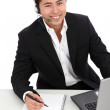 Young man working, with a laptop — Stock Photo #21804143