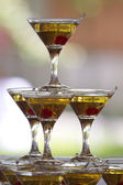 Pyramid cocktail glasses with martini — Stock Photo