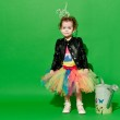 Girl is in studio on green background in different outfit — Stock Photo