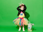 Girl is in studio on green background in different outfit — ストック写真
