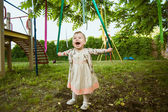 Cute little girl in dress at park — Stock Photo
