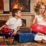 Children unwrap gifts — Stock Photo