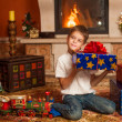 Child by fireplace — Stock Photo