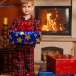 Child by fireplace — Stock Photo #36259165