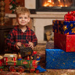 Child by fireplace — Stock Photo #36259195