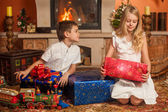 Children unwrap gifts — Stock Photo