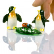 Two penguins ladybug and a master's hand ceremony. — Stock Photo