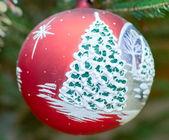 Xmas bauble on tree — Stock Photo