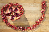 Pomegranate on wood — Stock Photo