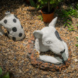 Stock Photo: Plaster dog in garden