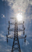 Silhouette of high voltage tower with blue sky — Stock Photo