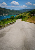 A curve road is leading to the beach — Stock Photo