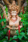 Ancient woman sculpture in the garden — Stock Photo