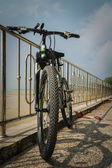 A bicycle parked on the walkway — Stockfoto