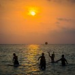 Silhouetted group of boy are playing a ball in the sea — Stock Photo #44058095